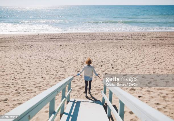 High Angle View Of Mid Adult Woman Walking By Footpath At Beach