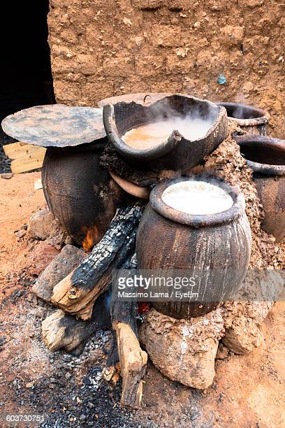 High Angle View Of Millet Beer Preparing In Earthenware Pots