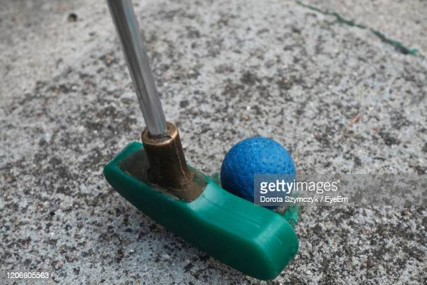 high angle view of minigolf club hitting ball - putting stock pictures, royalty-free photos & images