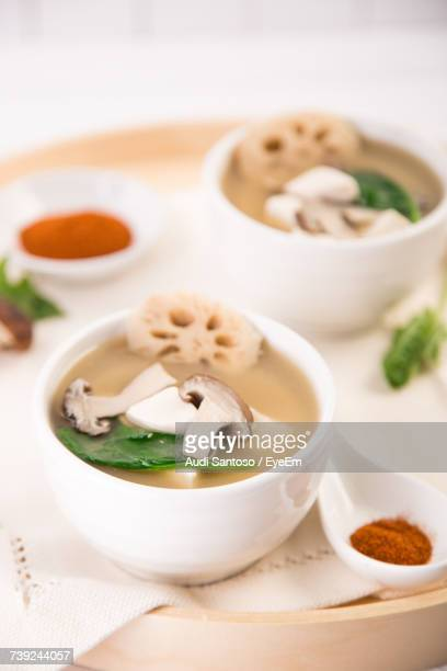High Angle View Of Miso Soup With Mushrooms And Tofu In Bowls On Table