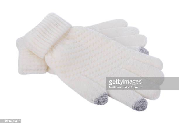 high angle view of mittens against white background - mitten stock pictures, royalty-free photos & images