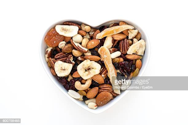 High Angle View Of Mixed Dried Fruits In Bowl On White Background