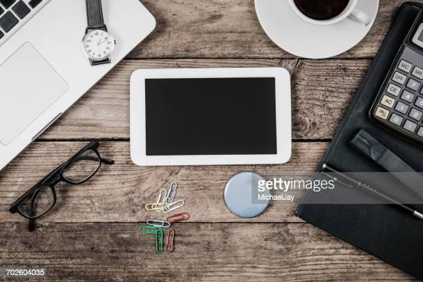 High Angle View Of Mobile Phone On Table