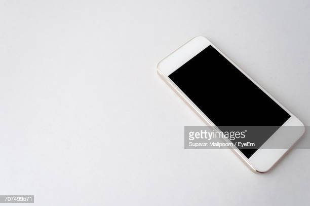 High Angle View Of Mobile Phone On Table