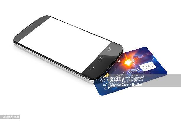 High Angle View Of Mobile Phone With Credit Card On White Background