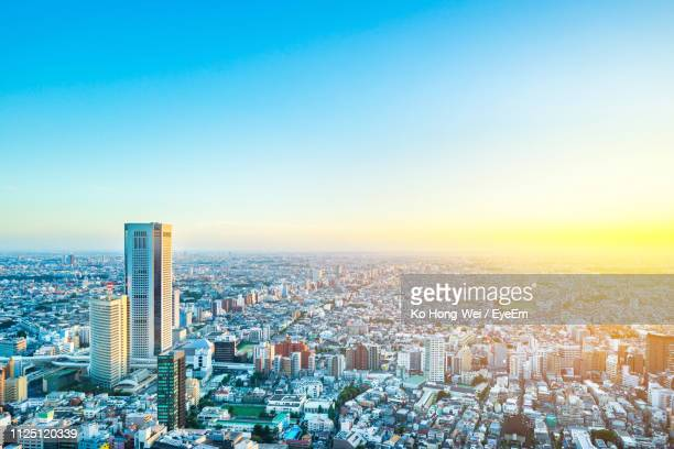 high angle view of modern buildings in city against clear sky - 都市景観 ストックフォトと画像