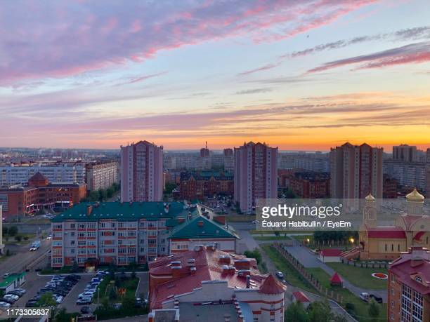 high angle view of modern buildings in city against sky during sunset - カザン市 ストックフォトと画像