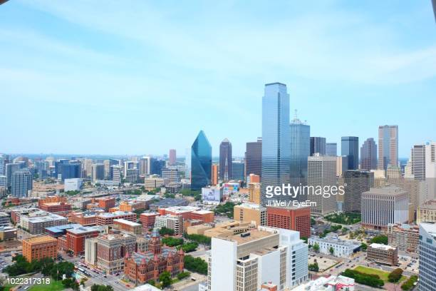 high angle view of modern buildings in city against sky - dallas stock pictures, royalty-free photos & images