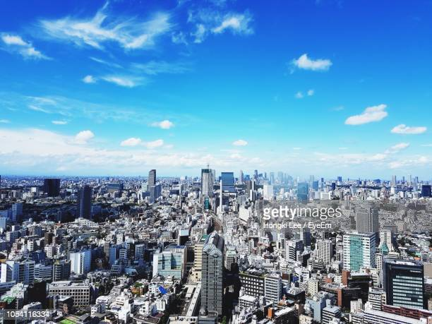 high angle view of modern buildings in city against sky - 金融街 ストックフォトと画像