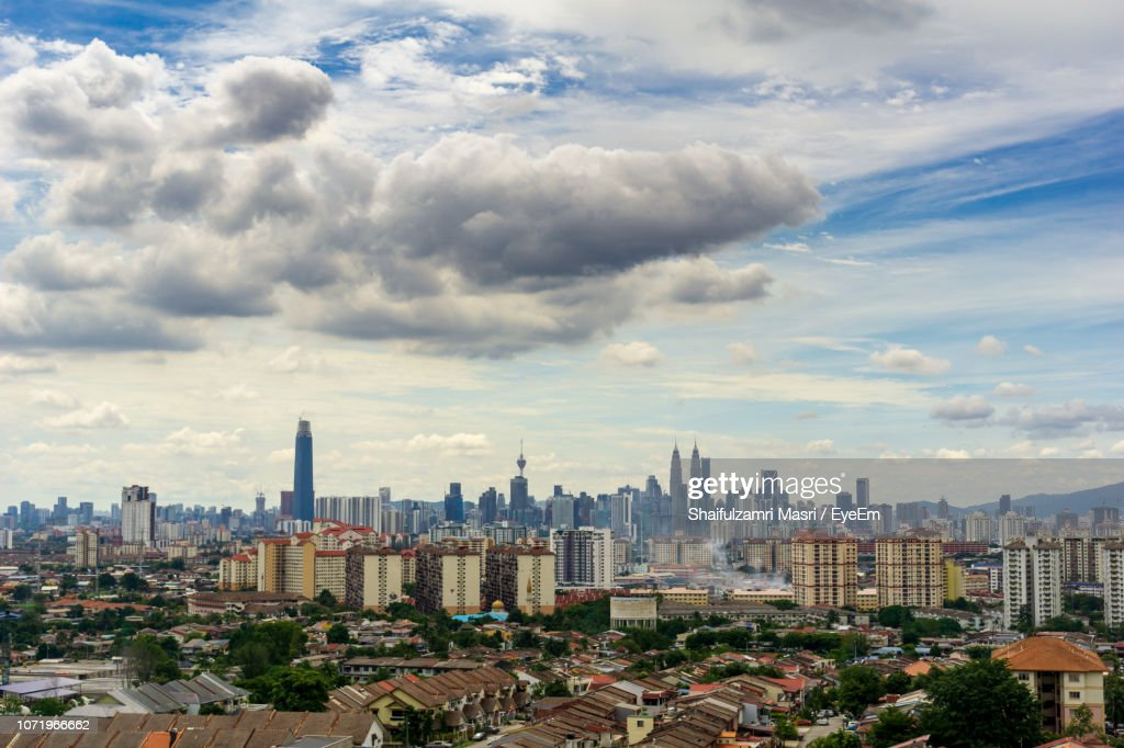 High Angle View Of Modern Buildings In City Against Sky : Stock Photo