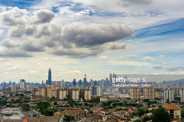 high angle view of modern buildings in city against sky - shaifulzamri eyeem stock pictures, royalty-free photos & images