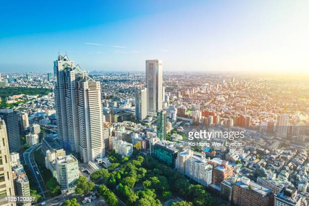 high angle view of modern buildings in city against sky - shinjuku ward stock pictures, royalty-free photos & images