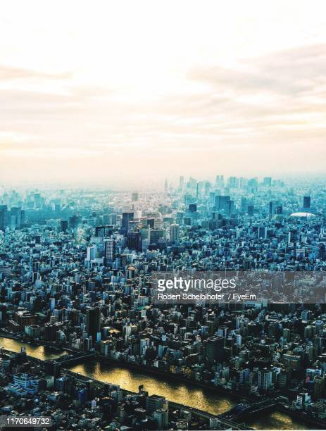 high angle view of modern buildings in city against sky - 縦位置 ストックフォトと画像
