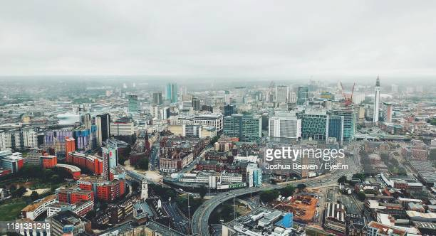 high angle view of modern buildings in city against sky - birmingham england stock pictures, royalty-free photos & images