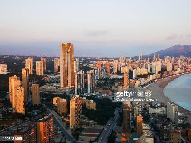 high angle view of modern buildings in city against sky - valencia stock pictures, royalty-free photos & images