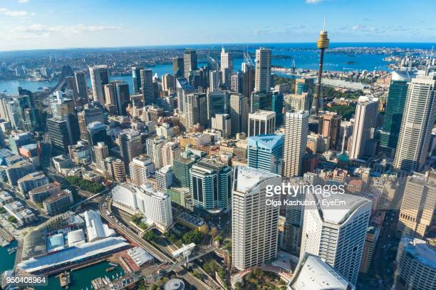 high angle view of modern buildings in city against sky - sydney stock pictures, royalty-free photos & images