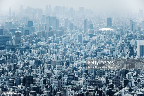 high angle view of modern buildings in city - 俯瞰 ストックフォトと画像
