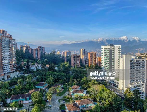 high angle view of modern buildings in medellin colombia against sky - medellin colombia stock pictures, royalty-free photos & images