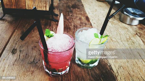 High Angle View Of Mojito Glasses On Wooden Table