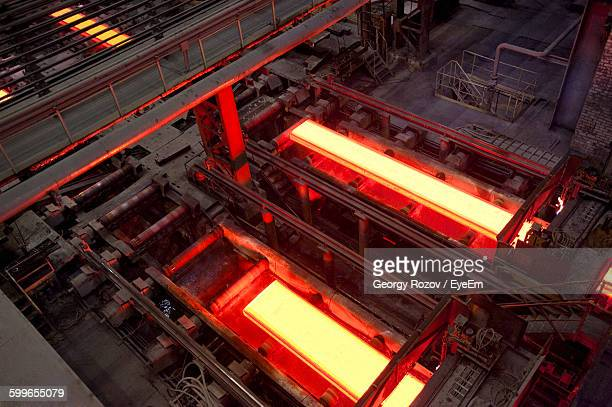 high angle view of molten steel in factory - steelmaking stock photos and pictures
