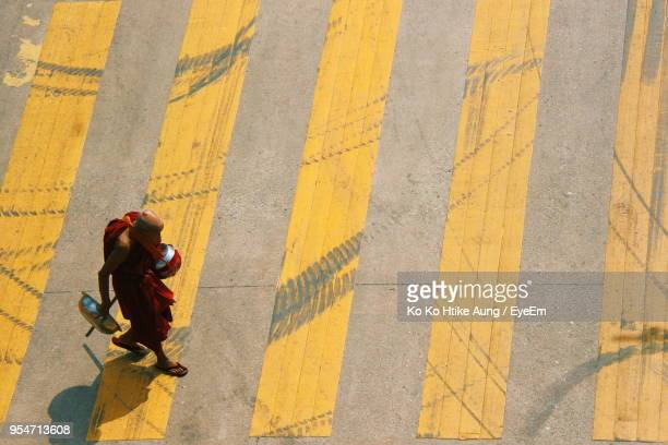 high angle view of monk walking on road - ko ko htike aung stock pictures, royalty-free photos & images
