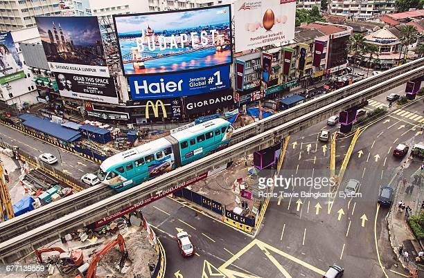 high angle view of monorail above street in city - monorail stock pictures, royalty-free photos & images