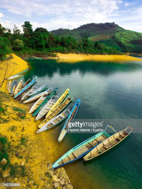 high angle view of moored by river against sky - sarawak state stock pictures, royalty-free photos & images