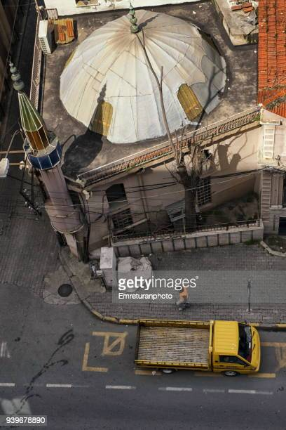 high angle view of mosque and pick- up truck and man walking in the street. - emreturanphoto stock pictures, royalty-free photos & images