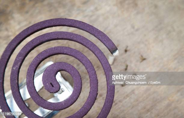 high angle view of mosquito coil on table - incense coils stock pictures, royalty-free photos & images