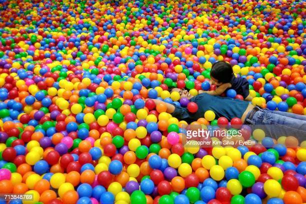 High Angle View Of Mother With Daughter In Colorful Ball Pool