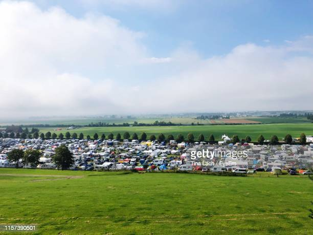 high angle view of motor homes parked on field - spielberg styria stock pictures, royalty-free photos & images