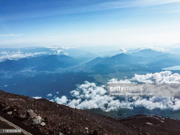 high angle view of mountain against sky - panaikorn chutidaralux stock photos and pictures
