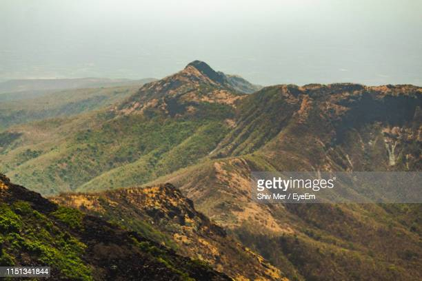 high angle view of mountain range - junagadh stock photos and pictures