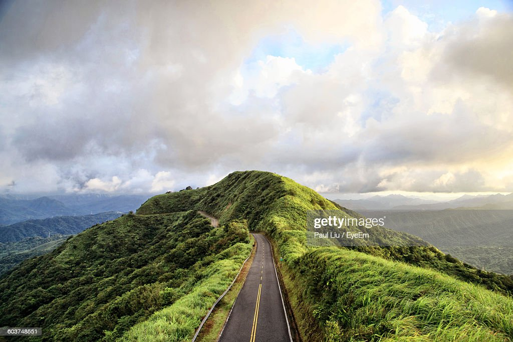 High Angle View Of Mountain Road Against Cloudy Sky : Stock Photo