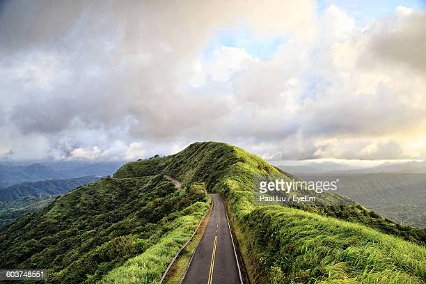 High Angle View Of Mountain Road Against Cloudy Sky