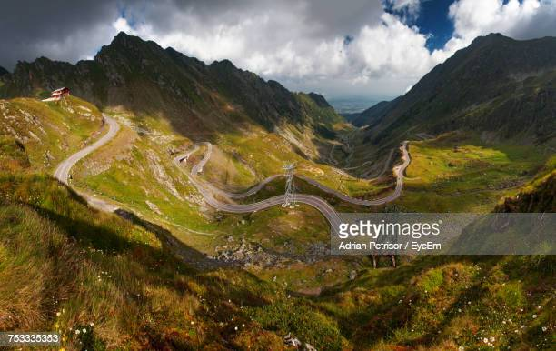 high angle view of mountain road against sky - sibiu stock photos and pictures