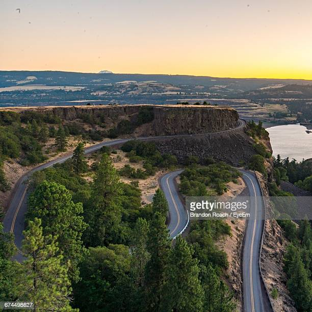 high angle view of mountain road at columbia river gorge during sunset - columbia river gorge stock pictures, royalty-free photos & images