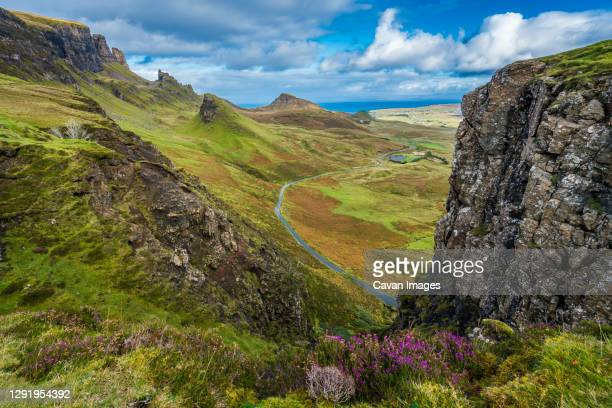 high angle view of mountain road at quiraing, isle of skye, scotland, uk - landscape scenery stock pictures, royalty-free photos & images
