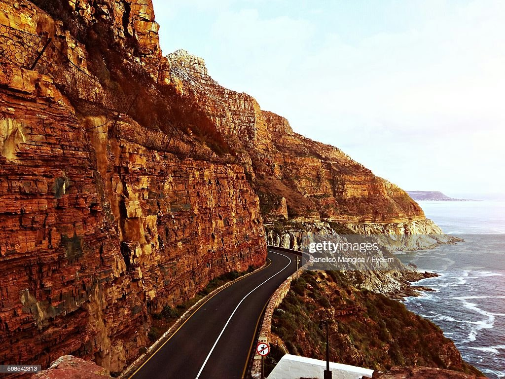 High Angle View Of Mountain Road By Sea Against Cloudy Sky : Stock Photo
