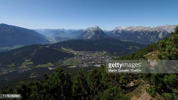 high angle view of mountains against clear blue sky - ゼーフェルト ストックフォトと画像