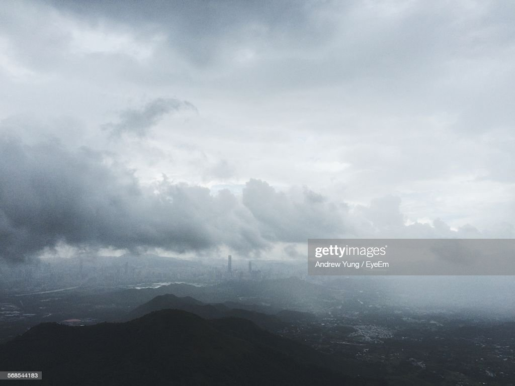 High Angle View Of Mountains Against Cloudy Sky On Foggy Day : Stock Photo