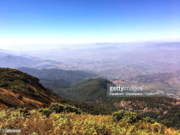 high angle view of mountains against sky - panaikorn chutidaralux stock photos and pictures