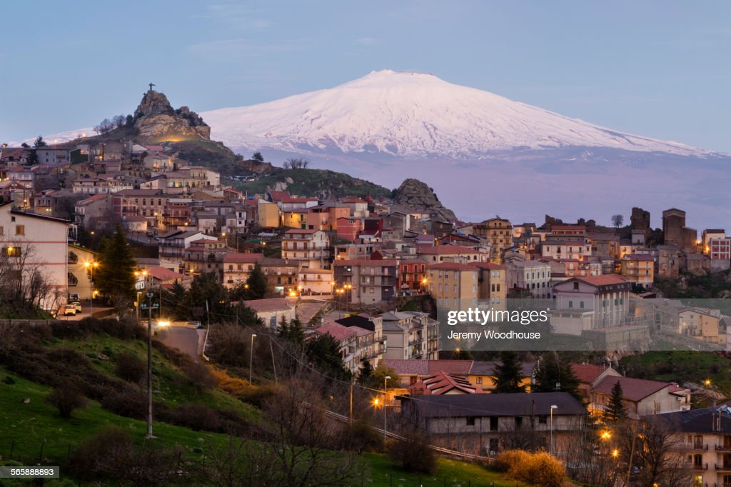 High angle view of Mt Etna over Cesaro cityscape, Messina, Sicily : Stock Photo
