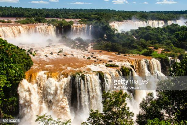 High Angle View Of Muddy Reddish Brown Waters Of Iguazu Falls