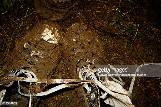 High angle view of muddy shoes