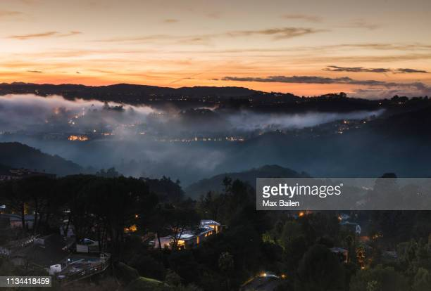 high angle view of mulholland drive at dusk, los angeles, usa - mulholland drive stock photos and pictures