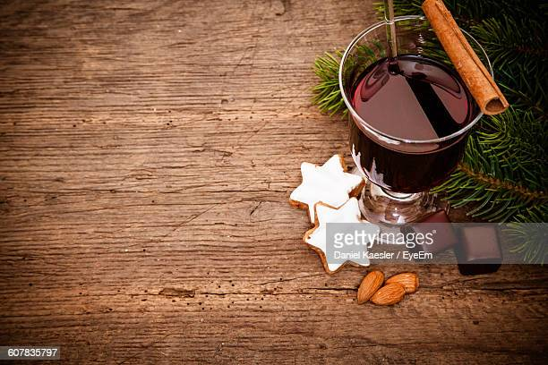 High Angle View Of Mulled Wine And Food On Table