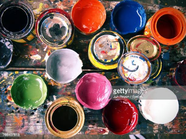 high angle view of multi colored aerosol cans - artist's palette stock photos and pictures