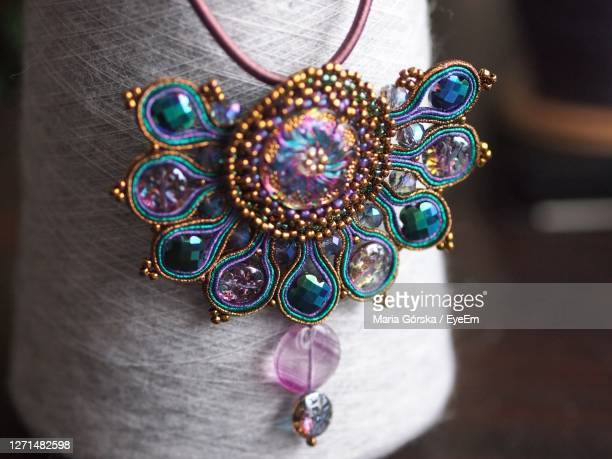 high angle view of multi colored beaded jewellery on alpaca yarn cone - bead stock pictures, royalty-free photos & images
