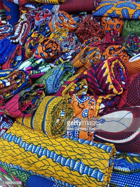 high angle view of multi colored blankets at market stall - côte d'ivoire stock pictures, royalty-free photos & images